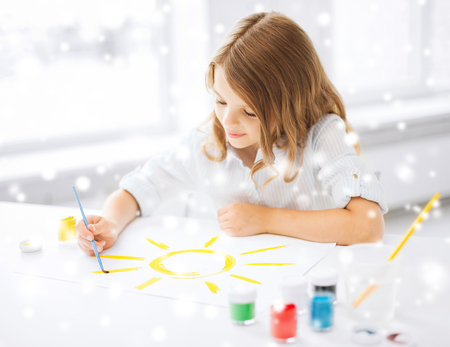 education, school, art and painitng concept - little student girl painting picture photo