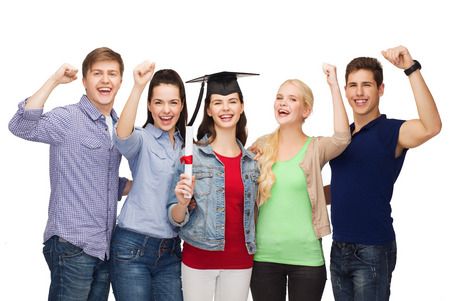 master degree: education and people concept - group of standing smiling students with diploma and corner-cap