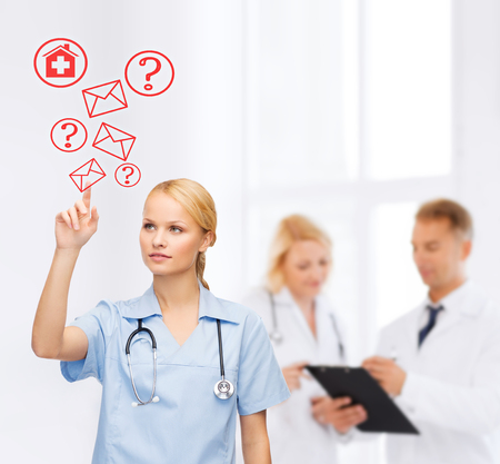 health questions: healthcare, medicine and technology concept - focused young doctor or nurse pointing to red envelope Stock Photo