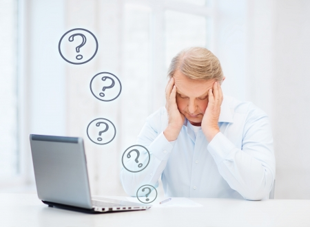 business, tax, office, school and education concept - stressed old man filling a form at home Stock Photo - 24117926