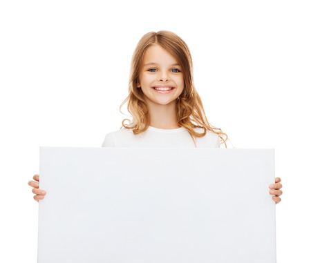 education and blank board concept - smiling little girl with blank white board photo