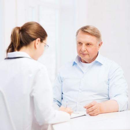 healthcare and medicine: healthcare, medicine and elderly concept - female doctor or nurse with old man prescribing