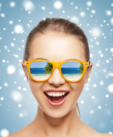 sunglasses reflection: picture of happy screaming teenage girl in shades