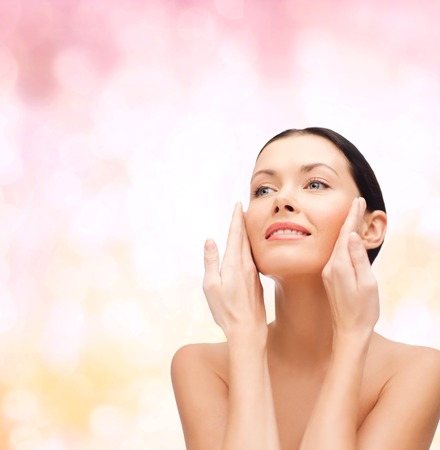 soft skin: beauty, spa and health concept - smiling young woman Stock Photo