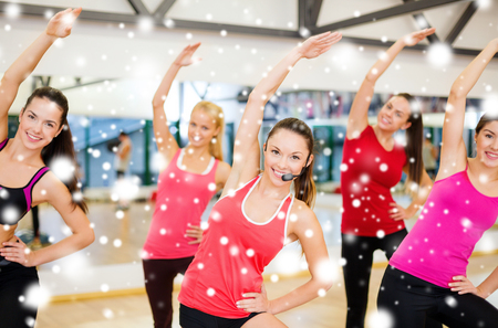 fitness, sport, training, gym and lifestyle concept - group of smiling people stretching in the gym 版權商用圖片