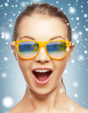 holidays, beauty and happiness - amazed girl in shades with beach reflection photo