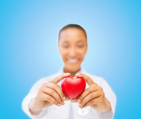 health and charity concept - close up of woman hands holding heart Stock Photo - 24220944