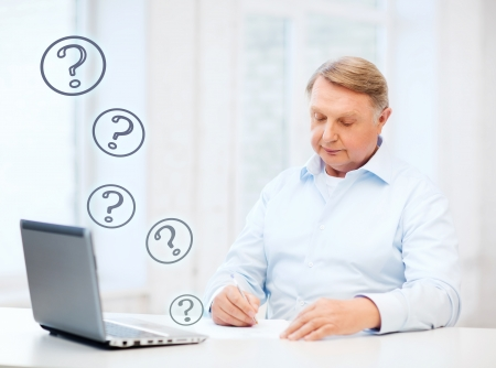 tax office: business, tax, office, school and education concept - old man filling a form at home