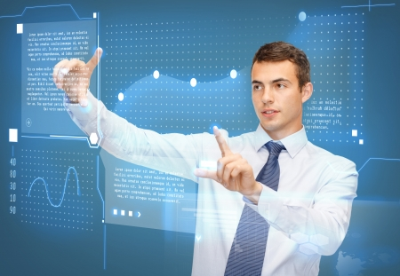 business, new technology and communication concept - businessman working with virtual screen and graphs on it photo