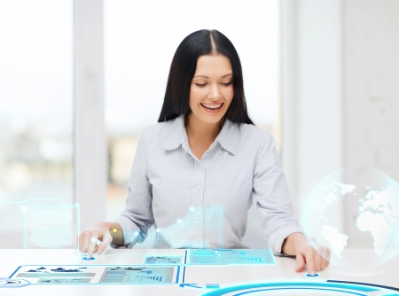 business, education and new technology concept - smiling woman pressing button on virtual screen photo