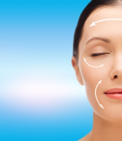 beauty, spa and health concept - relaxed young woman with closed eyes photo