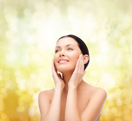 beautiful skin: beauty, spa and health concept - smiling young woman Stock Photo