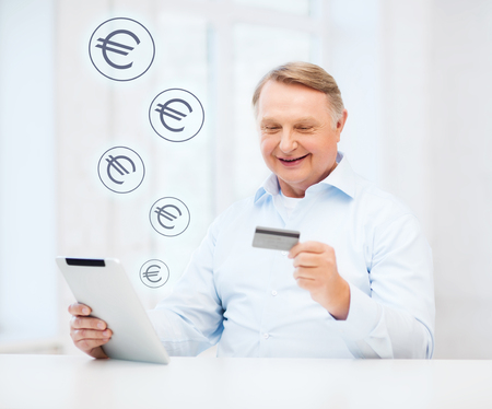 cash card: business, oldness, online banking, internet shopping and oldness concept - smiling old man with tablet pc and credit card at home