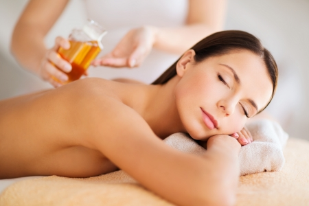 aromatherapy: beauty, spa, resort and relaxation concept - beautiful woman in spa salon