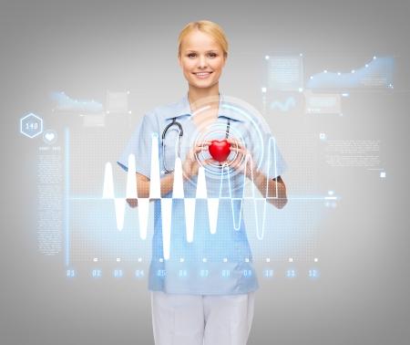 corazon humano: salud y la medicina concepto - sonriente mujer m�dico o enfermera con el coraz�n, estetoscopio y electrocardiograma