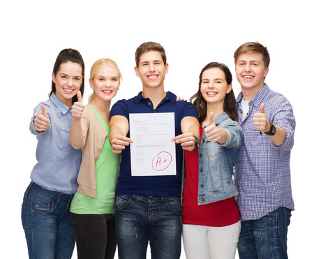 thumbs up group: education and people concept - group of smiling students standing and showing test and thumbs up