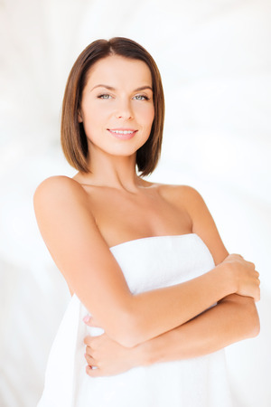 pampered: beauty, spa and people concept - beautiful woman standing in towel