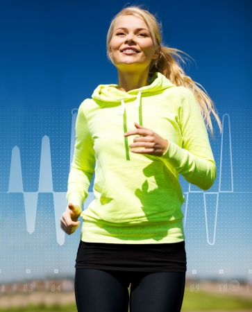 fitness, sport, training and lifestyle concept - smiling female runner jogging outdoors photo