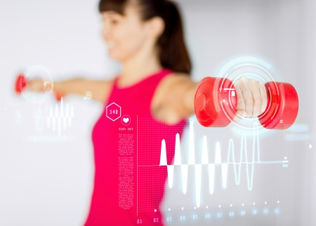 スポーティな女性手光赤いダンベル スポーツ、フィットネス、トレーニング、幸福のコンセプト-