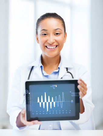 healthcare, medicine and technology concept - african female doctor with tablet pc Stock Photo - 24221839