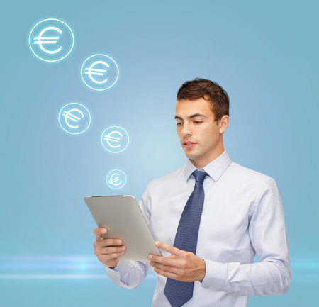 business, money, modern technology and office concept - buisnessman with tablet pc and euro icons photo