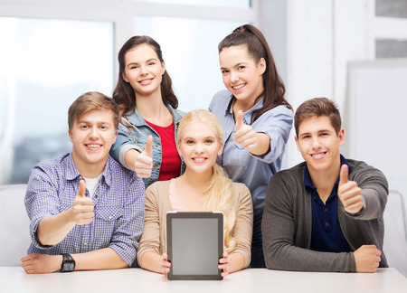 thumbs up group: education, technology, advertisement and internet concept - group of smiling students with blank black tablet pc screen showing thumbs up