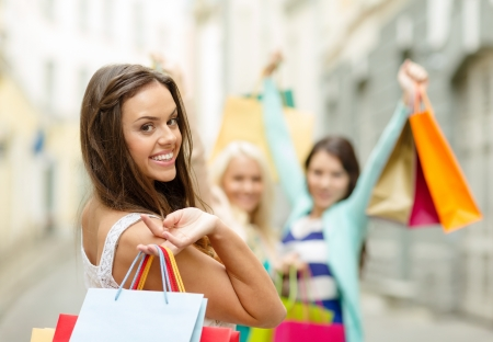 girl in dress: sale, shopping, tourism and happy people concept - beautiful woman with shopping bags in the ctiy