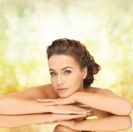 facial treatment: bride, health and beauty concept - dreaming woman with the mirror