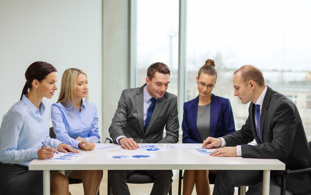 business and office concept - business team with documents having discussion in office photo