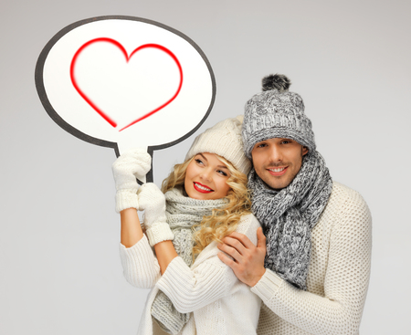 lovely couple: winter, relationships and happiness concept - family couple with blank text bubble Stock Photo