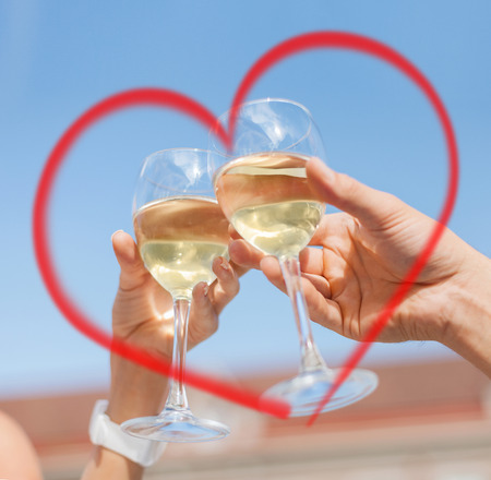 summer holidays and dating concept - couple drinking wine in cafe in the city photo