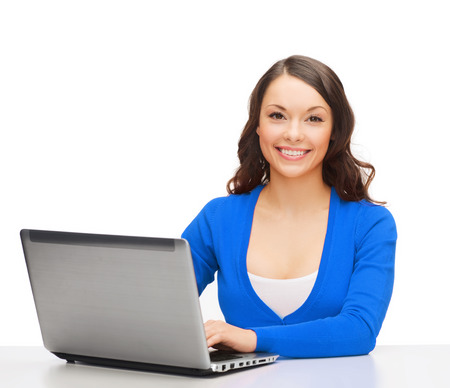 distant work: electronics and gadget concept - smiling woman in blue clothes with laptop computer Stock Photo