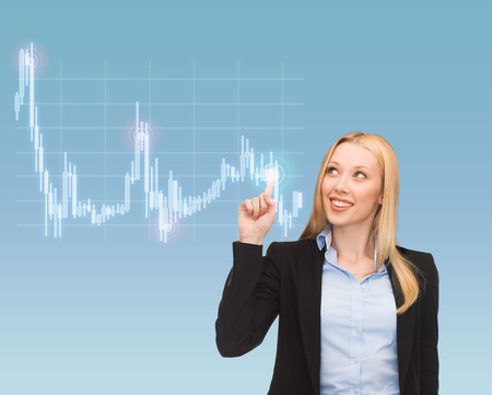 business, money and new technology - smiling businesswoman pointing to forex chart on virtual screen Stock Photo - 24371302