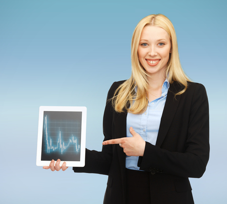 business , money and technology concept - smiling businesswoman with tablet pc and forex chart in it Stock Photo - 24371303