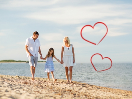 summer holidays, children and people concept - happy family walking at the seaside photo
