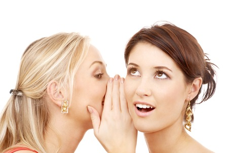 hearsay: friendship, happiness and people concept - two smiling women whispering gossip