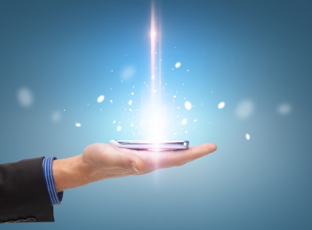technology and communication concept - close up of man hand with smartphone