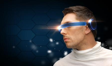 futuristic man: future technology concept - handsome man with futuristic glasses