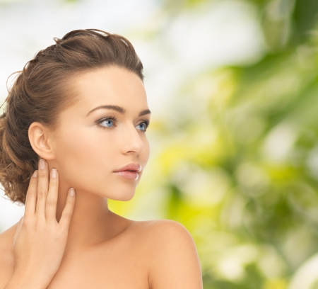 eco sensitive: health and beauty concept - face and hands of beautiful woman with updo