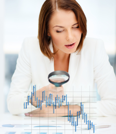 business, money, documents and office concept - businesswoman working with graphs and forex chart in office photo
