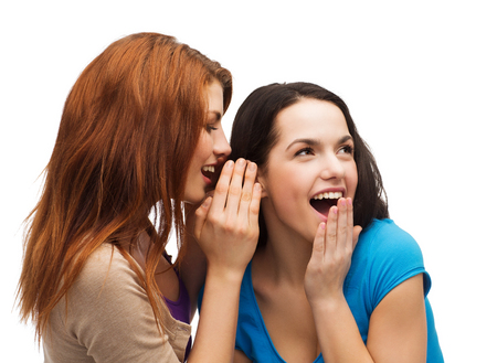 rumor: friendship, happiness and people concept - two smiling girls whispering gossip