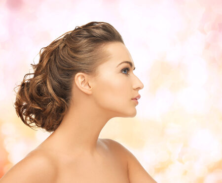 beautiful bride: health and beauty concept - face of beautiful bride with evening updo