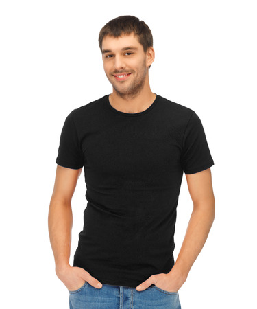 clothing design concept - handsome man in blank black t-shirt photo