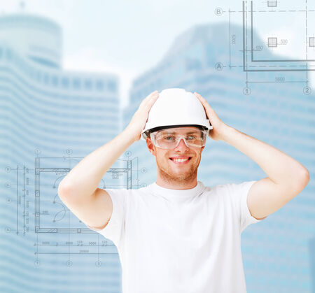 male architect in white helmet with safety glasses photo