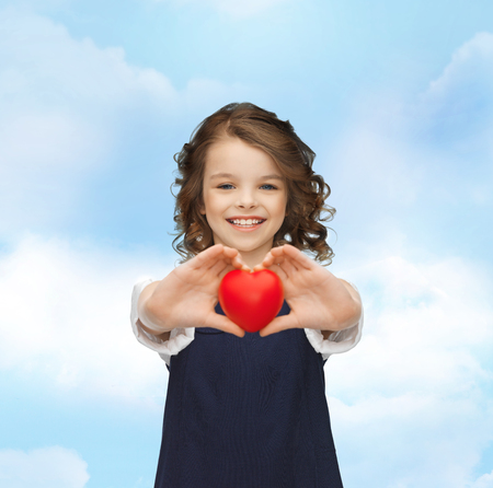 beautiful girl with small heart photo