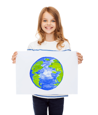 smiling little child holding picture of planet photo