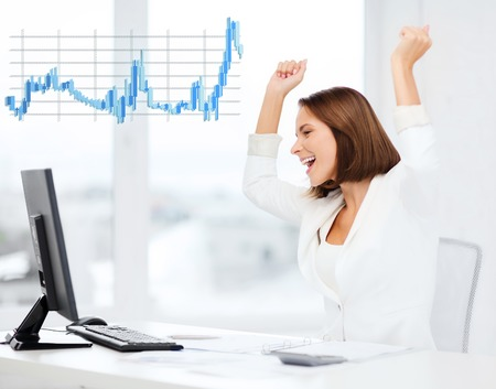 forex: happy businesswoman with computer in office