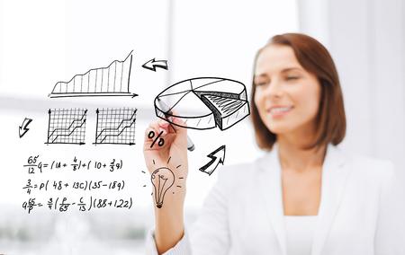 smiling businesswoman writing chart on virtual screen photo