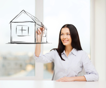 accommodation broker: smiling woman drawing house on virtual screen Stock Photo