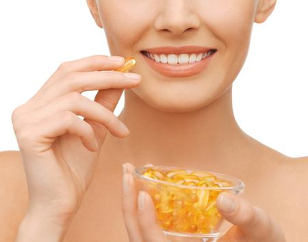 omega 3: beautiful woman with omega 3 vitamins